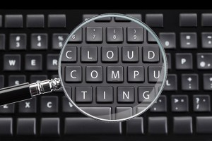 CLOUD COMPUTING written on keyboard with magnifying glass