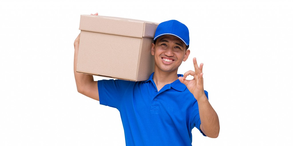 Asian delivery man carrying a parcel box and giving OK sign